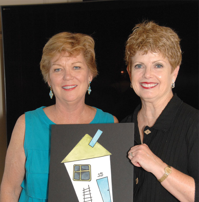 Lizby Eustis W.A.T.C.H. Co-Chair and Carol Lapari unveiling the 2015 W.A.T.C.H. pin.